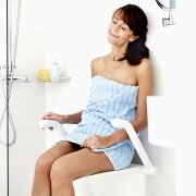Shower seat - etac - wall mounted - user sitting relaxing